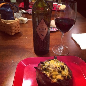 Beran wine bottle and glass with twice baked potato